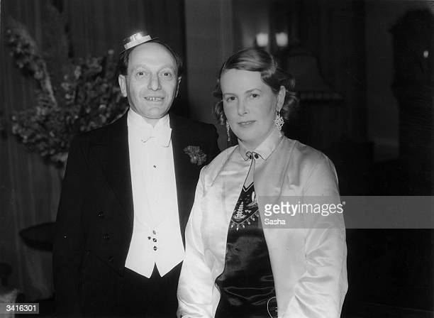 Mr Edward Simmons with Mrs R Rickett at Sir Edward Mountain's party thrown at his medieval house 'The Abbey', Campden Hill, London.
