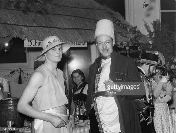Mr G Nutt and Mr S Stanford at Sir Edward Mountain's party thrown at his medieval house 'The Abbey', Campden Hill, London.