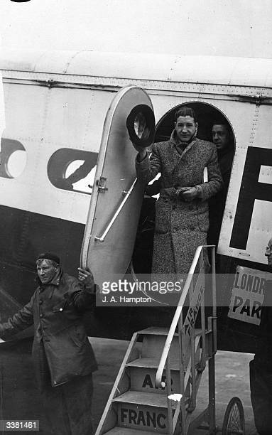 Jock McAvoy British and Empire middleweight boxing champion boarding a plane for Paris