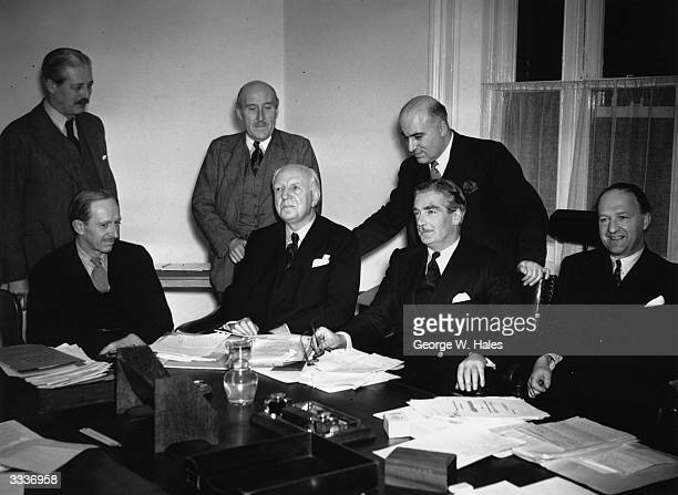 Harold Macmillan , Captain H F Crookshank , Sir David Maxwell Fyffe and Lord Salisbury , Lord Woolton , Anthony Eden and R A Butler at a meeting at...
