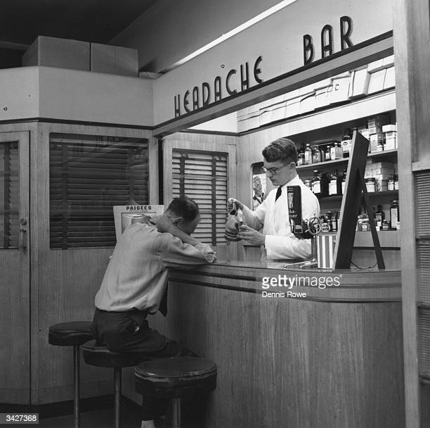A customer waiting for his medication at the Headache Bar in a pharmacy in Sydney Australia Among the items on sale are 'Paigees with Chlorophyll'...