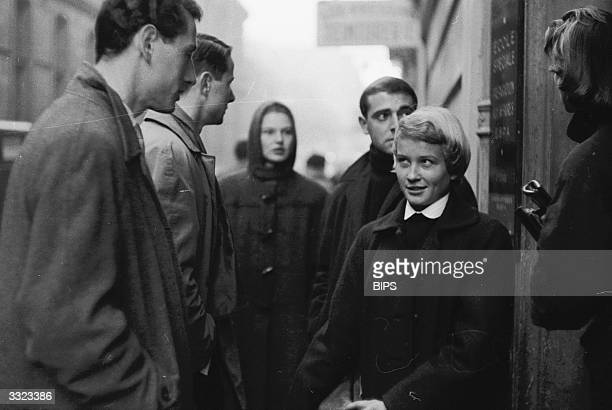 Jackie Bourgeois a niece of the French stage performer Mistinguett talking to friends at the gates of the Sorbonne Paris