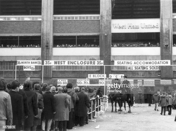 Football fans queuing to get tickets at West Ham's home ground Upton Park for the game against Manchester United