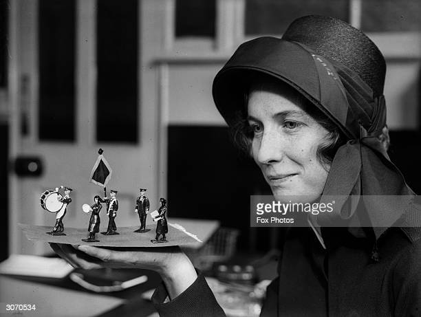 A Salvation Army worker at the movement's London headquarters examines the first of a collection of toy soldiers with a difference These are soldiers...
