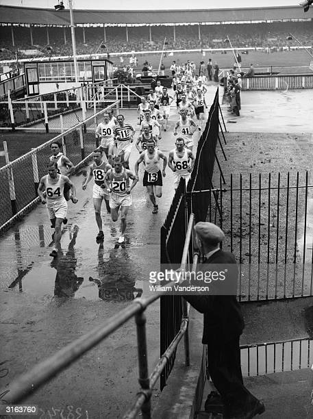 Contestants running out of the White City stadium at the start of the marathon during the AAA Championships