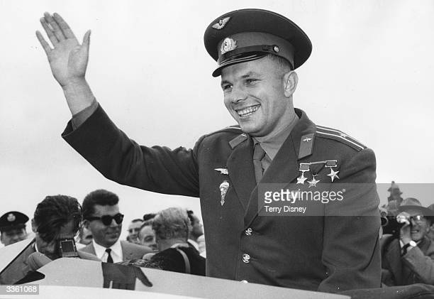 Russian cosmonaut Major Yuri Gagarin the first human to enter space waves to crowds who have come to see him at the Soviet exhibition at London's...