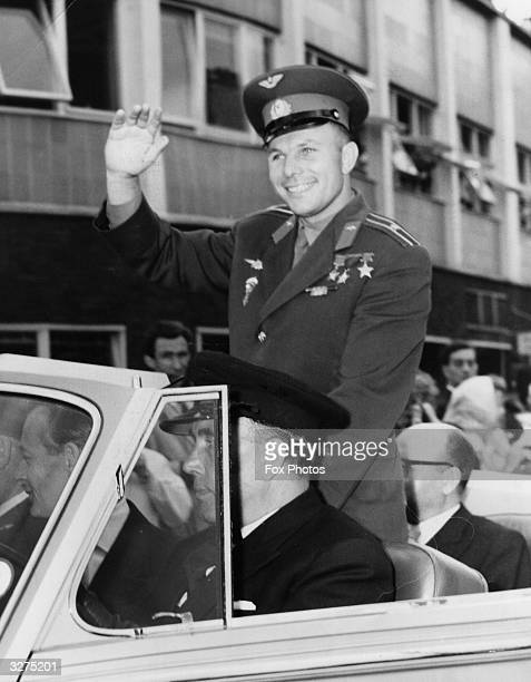 Russian Cosmonaut Major Yuri Gagarin waving to the crowds in London after arriving at London Airport for a stay in England