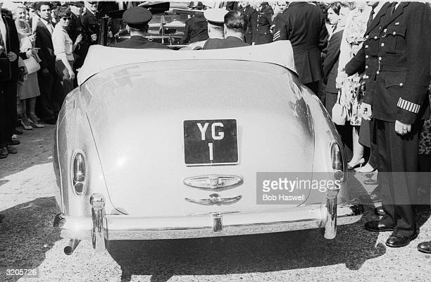 Russian cosmonaut Yuri Gagarin driving through the streets of London in a convertible with a personalised number plate 'YG 1'