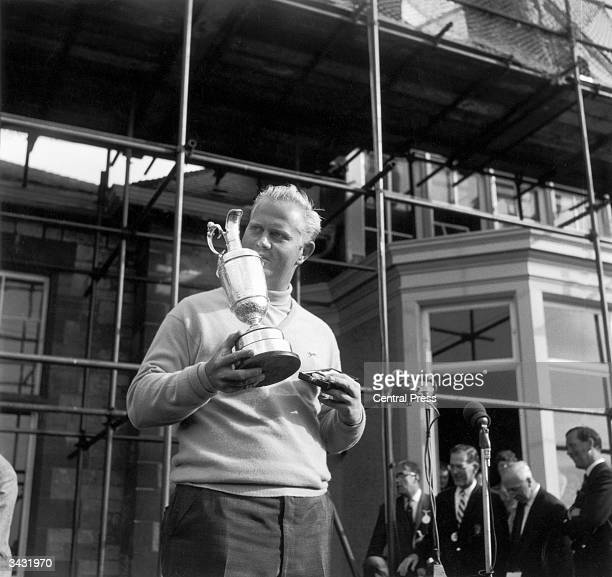 American golfer Jack Nicklaus with the trophy after his victory in the British Open at Muirfield He won by a single stroke with a 70 in the final...