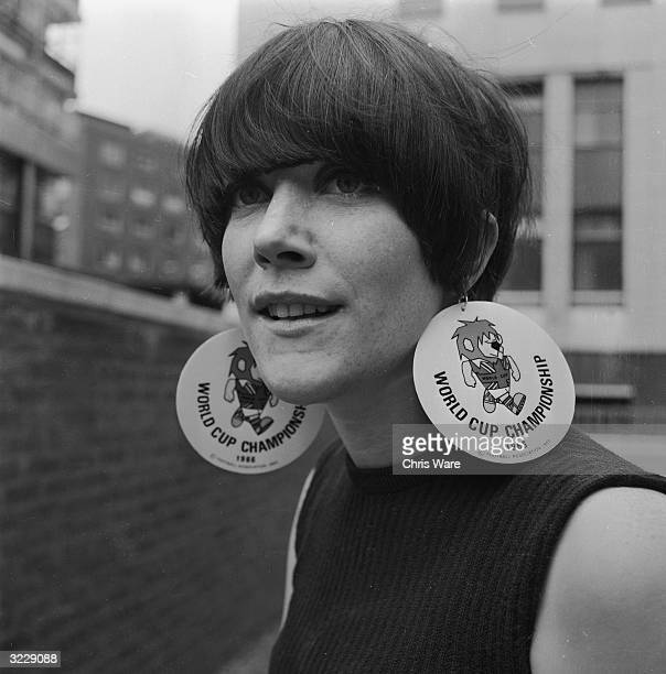 Football fan Elaine Humby from Streatham London wearing decorative World Cup earrings to the kickoff match between England and Uruguay at Wembley