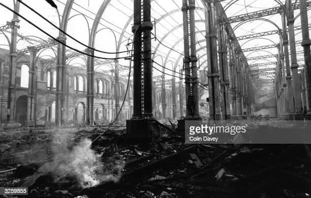 Embers smouldering on the floor of the Great Hall of Alexandra Palace north London after fire swept through it