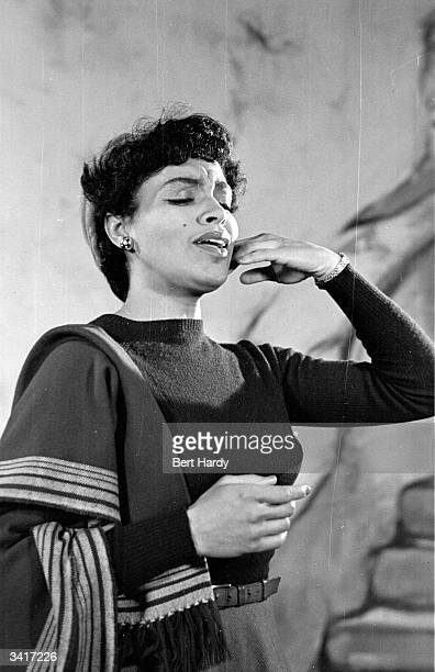 American opera and revue singer Muriel Smith during a performance of Sauce Tartare at the Cambridge Theatre. Original Publication: Picture Post -...