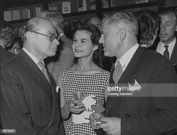 The Director of the Tate Gallery in London Sir John Rothenstein with actress Imogen Hassall and Christopher Hassall