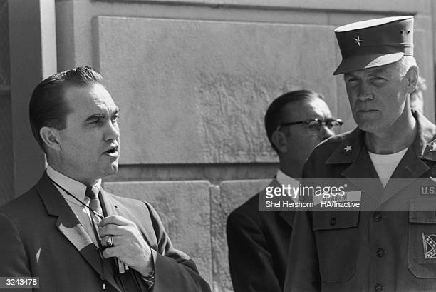Segregationist Alabama Governor George C. Wallace blocks the doorway to the University of Alabama while talking to Brigadier General Henry Graham of...