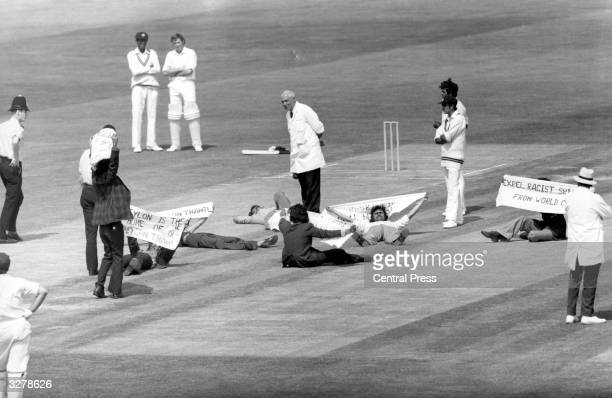 Demonstrators hold up a game of cricket at the Oval cricket ground when Australia were playing Sri Lanka in the Prudential World Cup Match