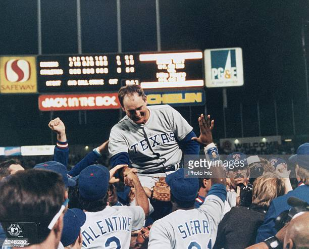 Texas Rangers pitcher Nolan Ryan smiles as his teammates carry him on their shoulders celebrating his sixth nohitter in their win against the Oakland...