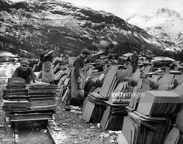 Stacking slates at Elterwater Quarry, Ambleside, the Lake District, for packing and despatch to Mesopotamia for the Basra War Memorial.