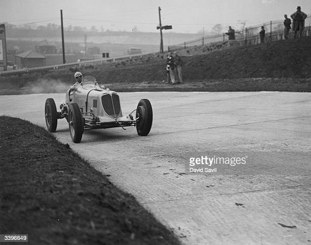 Motor racing driver B Bira during a practice run in his Maserati at Brooklands racing track Surrey