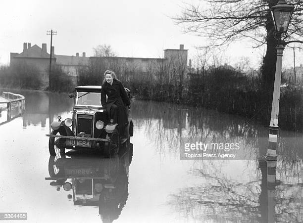 A stranded motorist in the flood waters in Perivale Lane Greenford Middlesex where the River Brent has overflowed