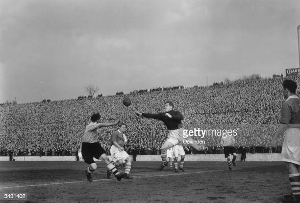 Sam Bartram the Charlton Athletic goalkeeper beating the Arsenal player Peter Goring to the ball during a match at the Valley Ground London