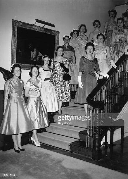 Wife of the American Ambassador to Britain Mrs Jock Whitney with 12 American debutantes at a Presentation Party in Buckingham Palace Regent's Park...