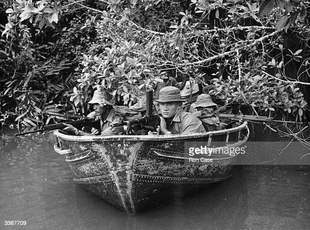 Men of the 2nd Battalion 7th Duke of Edinburgh's own Gurkhas patrol the river Limbang near the frontier of the 'Forgotten War' in North Borneo