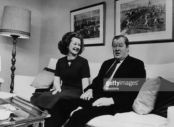 Lord Spencer and Lady Spencer sitting hand in hand in their hotel suite while on a visit to Munich Lord Spencer is the father of Lady Diana Spencer...