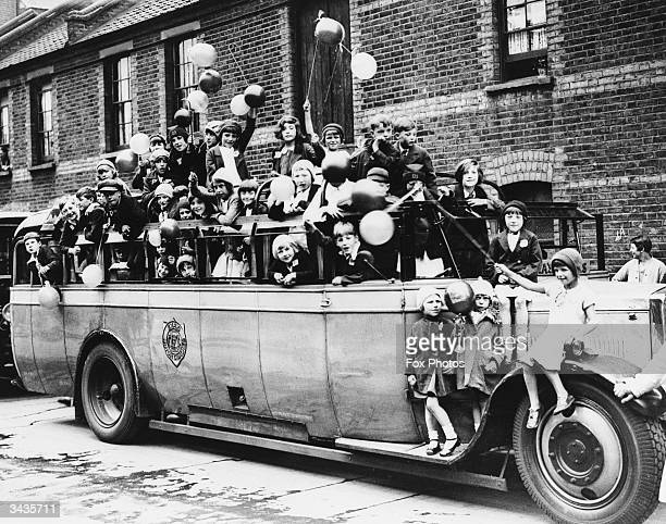 Children from Bethnal Green crowded into a charabanc on a trip to High Beech Epping Forest
