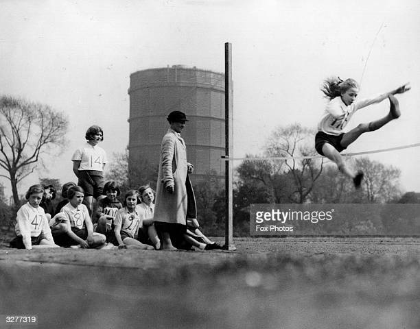 Schoolgirls from Cook Ground Senior Girls School in Chelsea taking part in the highjump during their sportsday in Battersea Park Note the Mann...