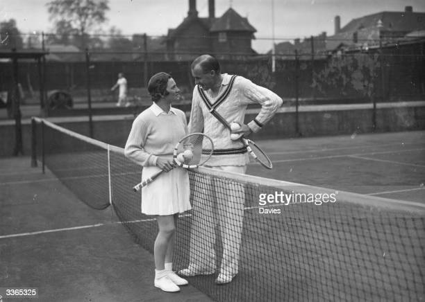 American tennis players Helen Jacobs and Bill Tilden chatting between practice games at the Melbury Club in London