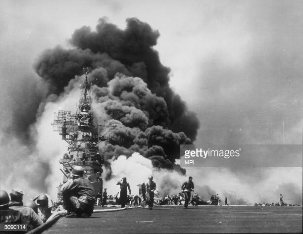 Black smoke billows into the air from a kamikazi plane which hit the SS Bunker Hill during a Japanese air strike near Okinawa.