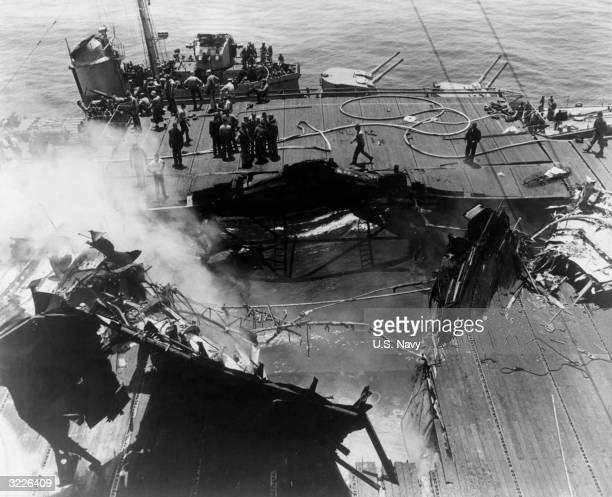 Overhead view of the gaping hole in the deck of the USS 'Bunker Hill' after it was dive-bombed by two Japanese Kamikaze planes off the shores of...