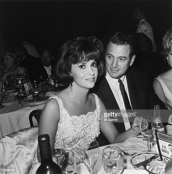 American actor Rock Hudson with Italian actress Gina Lollobrigida at Pat Boone's opening at the Cocoanut Grove in Hollywood California