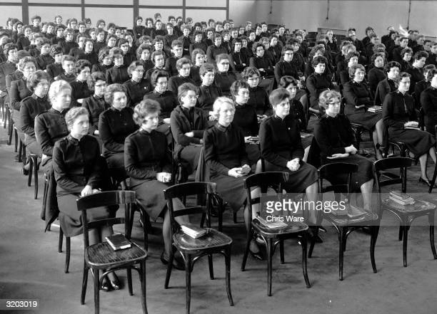 Women cadets listen to an address in the lecture hall of the Salvation Army training college in Denmark Hill south London