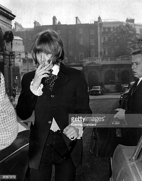 Brian Jones guitarist and founder member of pop group the Rolling Stones arrives at court on a drugs charge