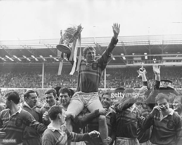 Rugby player M Clark captain of Leeds is held aloft by his teammates after victory over Wakefield Trinity at Wembley London He holds up the Rugby...