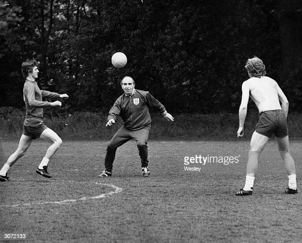 England football team manager Alfred Ramsey practices heading techniques with Alan Clarke and England's Captain Bobby Moore