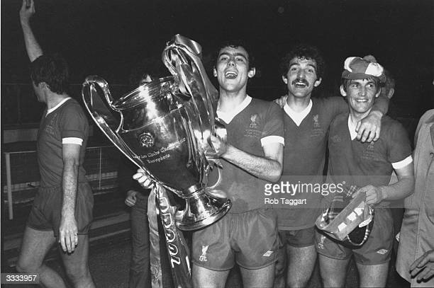 Footballer Ray Kennedy of Liverpool holds the European Cup trophy after beating FC Bruges 1 0 in the European Cup final at Wembley Stadium With him...