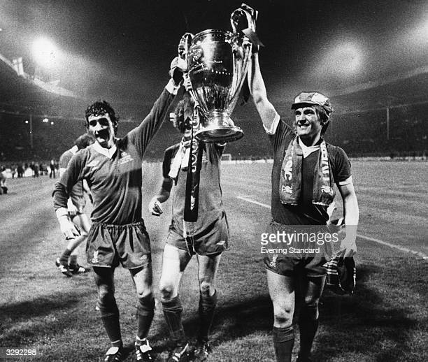 Terry McDermott and the winning goal scorer Kenny Dalglish hold aloft European Trophy after their 10 victory over FC Bruges in the European Cup final...