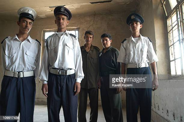 Young policemen stand in the looted police station, after the invasion of US forces in operation 'Shock and Awe' in March 2003, Amara, Iraq.