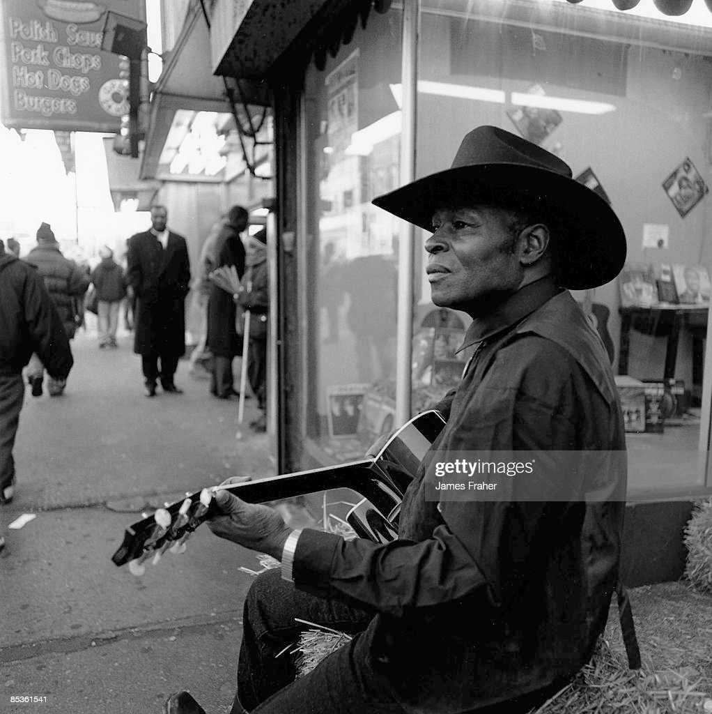 Blues guitarist Jimmie Lee Robinson performs live on a Chicago street on 11th May 1999.