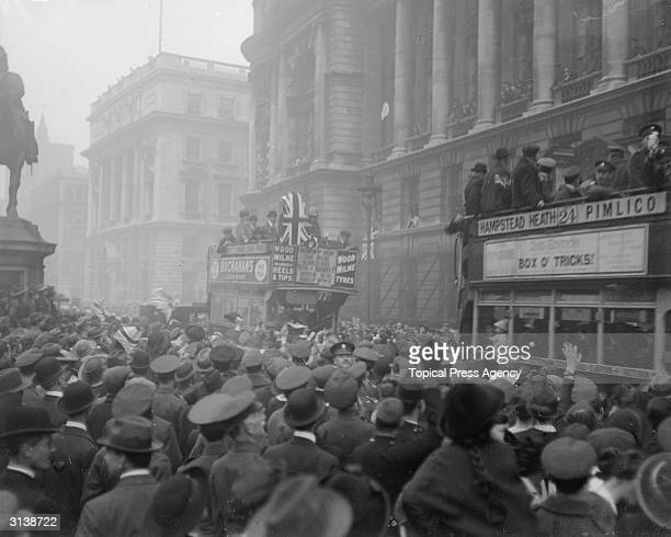 Crowds and buses in London when the armistice was signed bringing WW I to an end