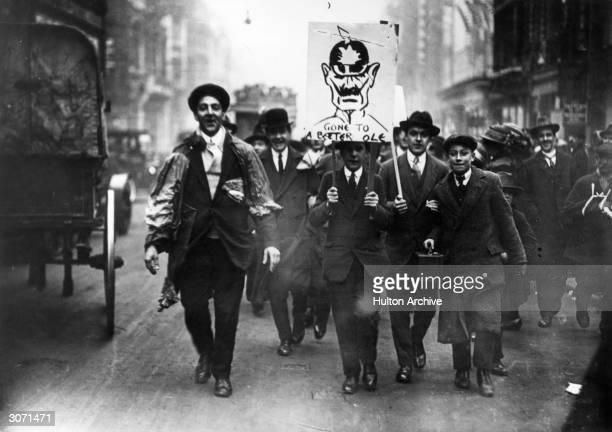 Crowds celebrating the Armistice in London