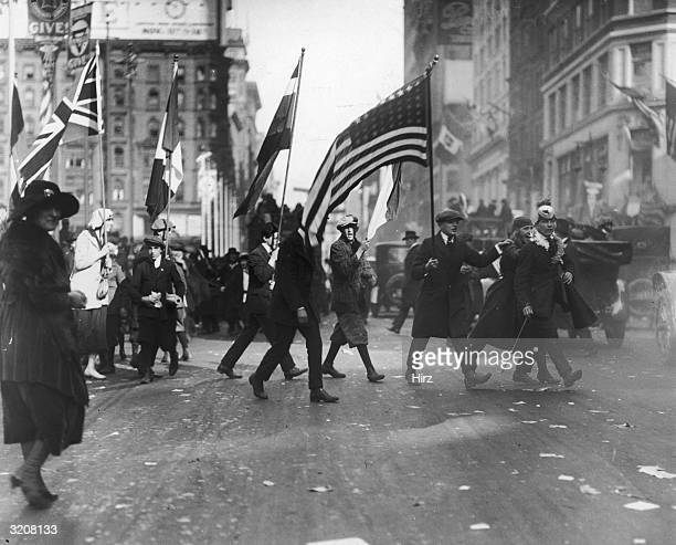 People celebrate Armistice Day on Fifth Avenue in New York City