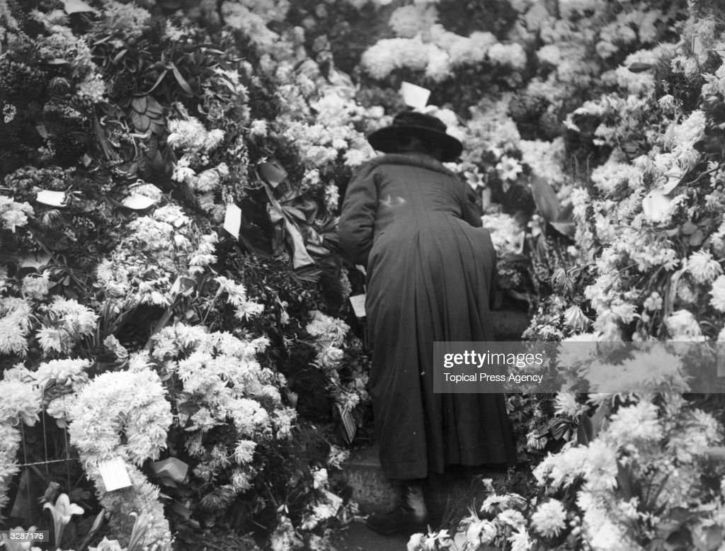 A woman placing flowers at the Cenotaph in memory of the dead of the Great War.
