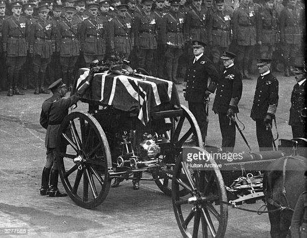 King George V placing a wreath on the coffin of the Unknown Warrior, at the Cenotaph, on Armistice Day.