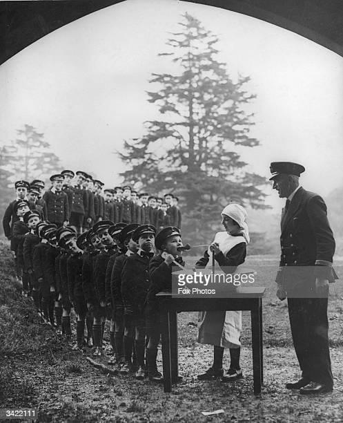 Boys lining up for a treat at the Royal Merchant Seaman's Orphanage at Bearwood Wokingham Berkshire