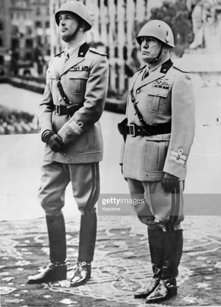 Italian dictator Benito Mussolini (1883 - 1945) and Crown Prince Umberto at the unknown warriors tomb in Rome on armistice day.