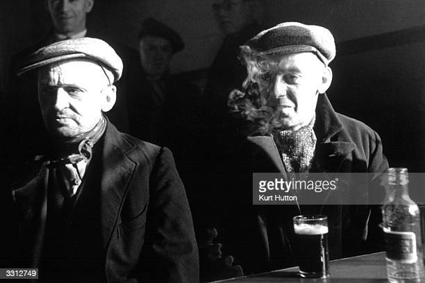 Two men drinking in a Wigan pub Original Publication Picture Post 228 Wigan pub 1939
