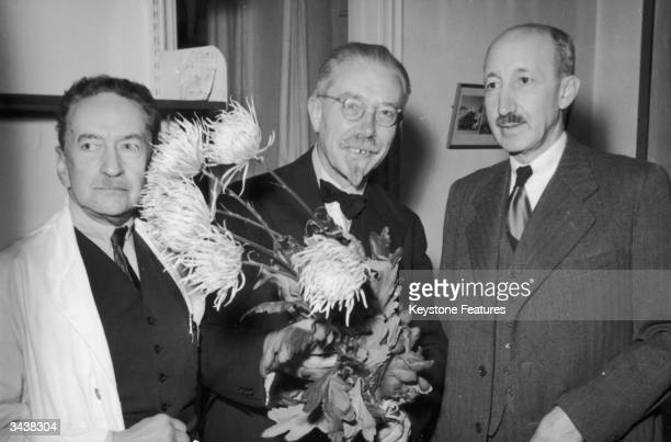 Hungarian chemist Georg Hevesy De Heves at Stockholm University with Nobel Prize winners Hans von EulerChelpin of Germany and Prof August Krogh of...